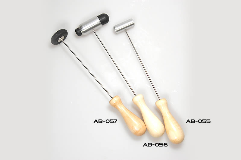 Touching hammer for tuning forks